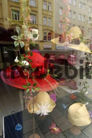 goods on display of a hatter hat vendor window Tuerken Street Munich Bavaria Germany