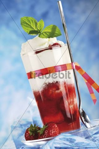 Strawberry dessert with whipped cream in a glass