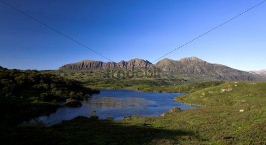 Quinag mountain range with a lake in the Scottish Highlands, Scotland, UK, Europe