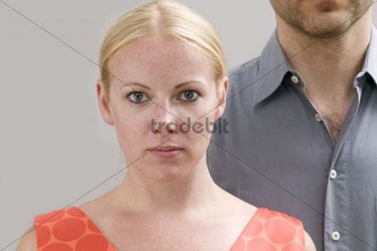 Young woman, behind her a young man