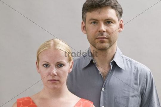 Young couple looking serious
