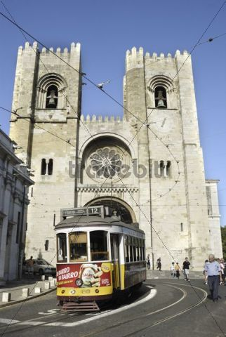 Yellow tram in front of the Catedral Sé Patriarcal cathedral, Lisbon, Portugal, Europe