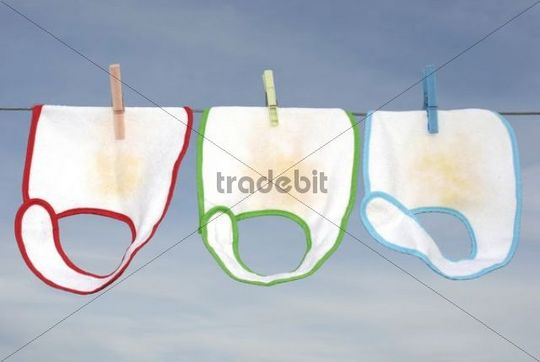Red, green and blue baby bibs laundry drying
