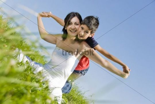 Mother and her 9-year-old son in a meadow