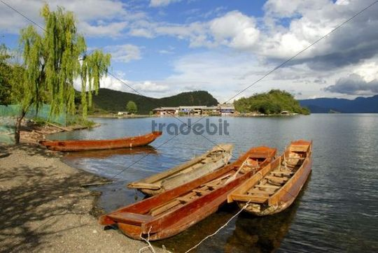 Wooden boats on the shore, Lige, Lugu Hu Lake, Yunnan Province, People´s Republic of China, Asia