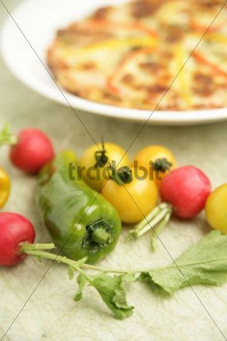 Various vegetables in front of a dish