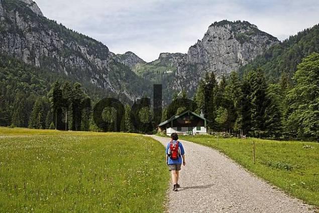 hiker at Alpine hut in Längental valley , Upper Bavaria, Germany