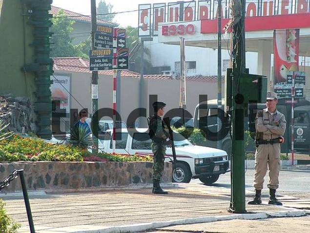 street scene with soldier and policeman in Asuncion, Paraguay