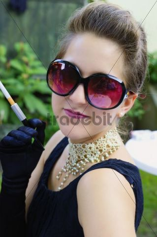 Young woman dressed like Audrey Hepburn