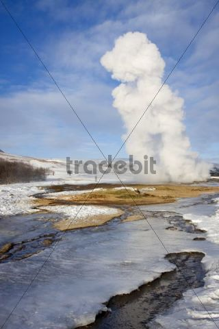 Strokkur outbreak at the geothermal geyser area in the winter, Iceland, Europe