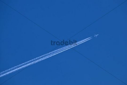 Airplane with multiple contrails in the blue sky