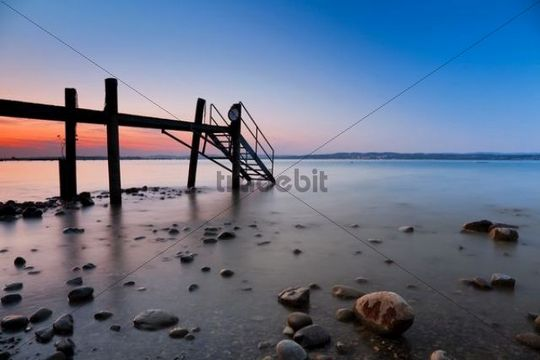 Evening mood with dock on Lake Constance in Altnau, Switzerland, Europe