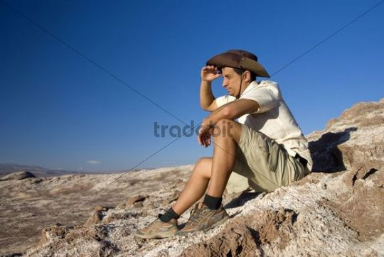 Young man, 25 +, looking out in the Atacama Desert, Chile, South America