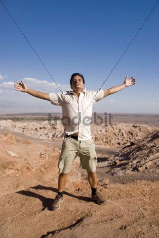 Young man enjoying the Atacama Desert, Chile, South America