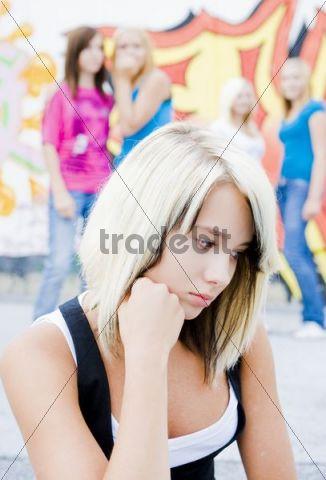 Teenage girl being bullied by peers