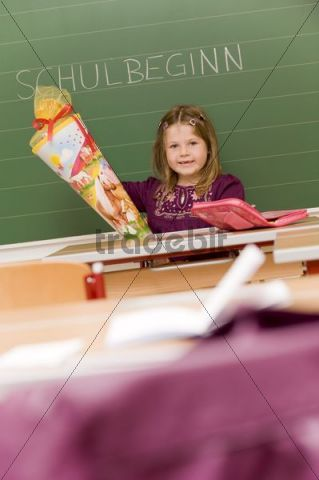 Firstgrader holding her school cone on the first day of school