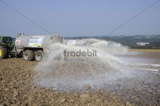 Dairy farmers dumping their milk in protest on a field, Overath, Rheinisch-Bergische Kreis, North Rhine-Westphalia, Germany, Europe