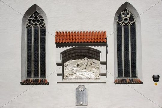 Stained-glass windows with religious stone image with writing, Kaufbeuren, Bavaria, Germany, Europe