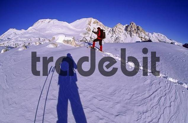 Woman snowshoeing at Col de Limo Fanes area South Tyrol Dolomites Italy