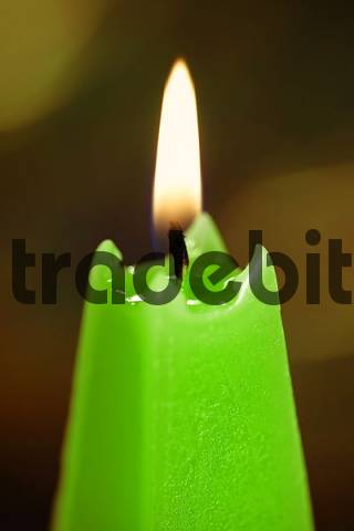 burning green candle