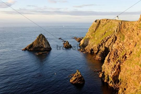 Northern Lighthouse in the evening sun of Fair Isle, Shetland, Scotland, United Kingdom, Europe