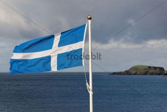 Flag of Scotland, in the back an island, Scotland, United Kingdom, Europe