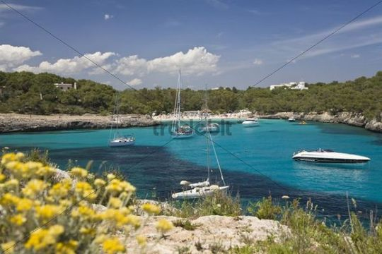 Sailing yachts in the Cala Mondragó bay, beach of Caló d´en Garrot, natural park of Mondragó, Mallorca, Majorca, Balearic Islands, Mediterranean Sea, Spain, Europe