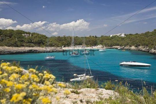 Sailing yachts in the Cala Mondragó bay, beach of Caló d´en Garrot, natural park of Mondragó, Mallorca, Majorca, Balearic Islands, Mediterranean Sea, Spain, Europe