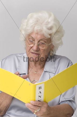 Senior woman with bank statement