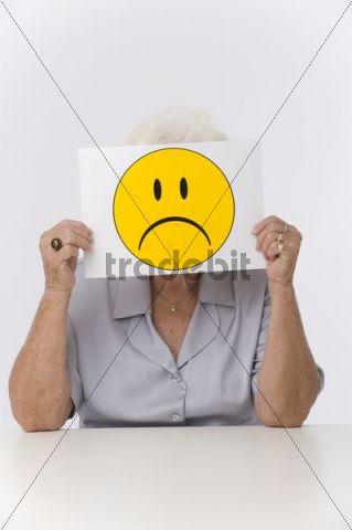 Senior woman with sad smiley face