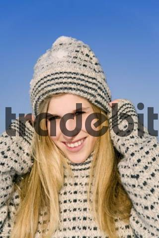 A young woman with a woolen sweater on a winter day