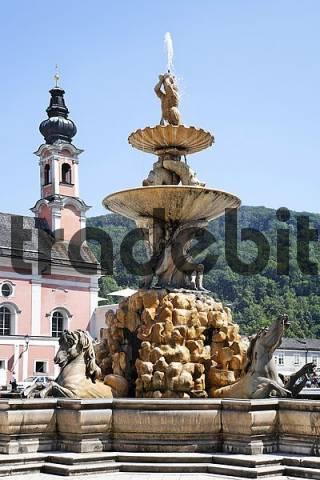 Residence fountain at Residence Square, church St. Michael, Salzburg, Austria