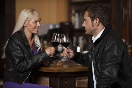 Man and woman sitting at the bar