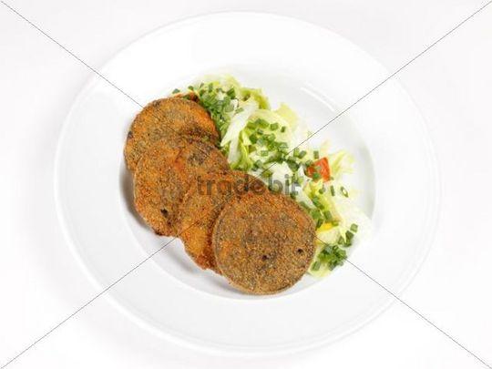 Blunzenscheiben, baked slices of black pudding on salad