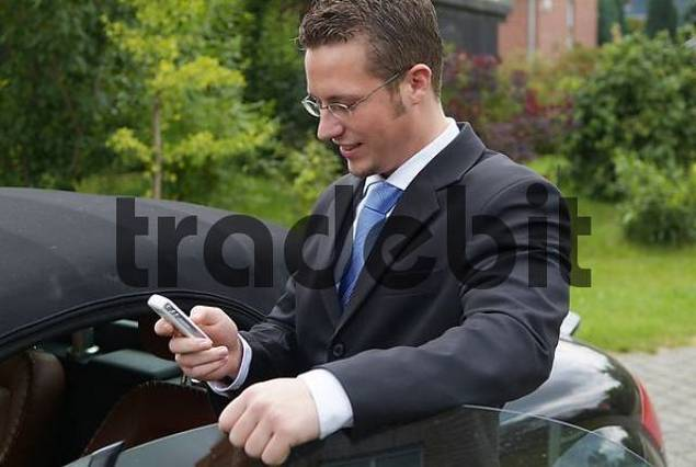 man telephones with mobile phone