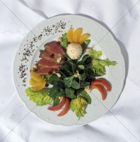 Low-calorie gourmet dish à la haute cuisine with delicate slices of fillet on rocket salad