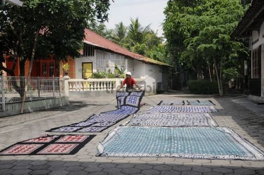 Batik factory drying the dyed fabrics in a yard near Yogyakarta, Central Java, Indonesia, Southeast Asia, Asia