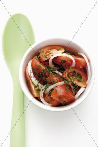 Small bowl with tomatoes, onions and chives