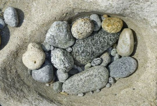 Polished granite stones in an eroded tidal basin, Tyrrhenian Sea, Mediterranean Sea, Italy, Europe
