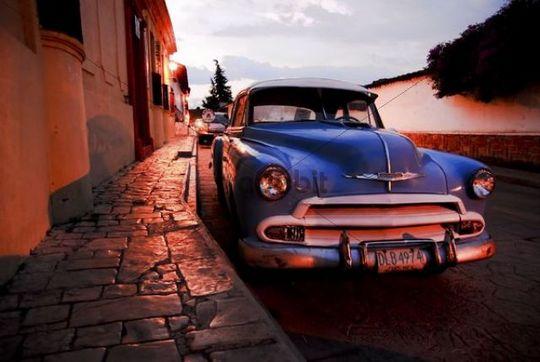 Blue vintage car at night in San Cristobal de las Casas, Mexico