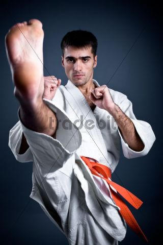 Man doing a high karate kick