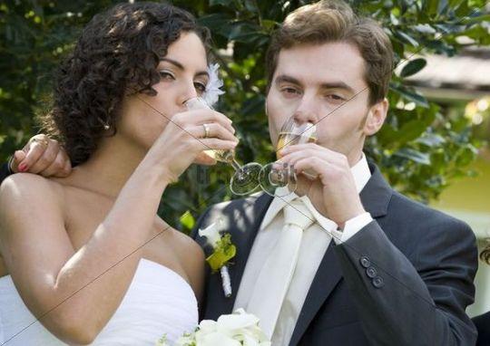 Wedding couple drinking sparkling wine