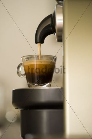 Coffee cup being filled in a coffee machine