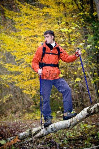 Man hiking through a forest in autumn