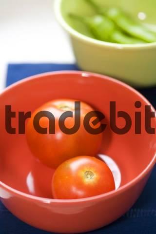 fresh vegetables in same colour bowl