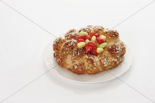 Savarin with sugar Easter eggs on a plate