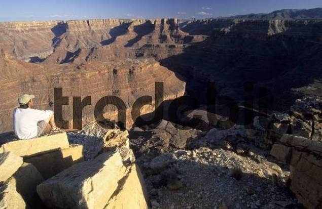 man sitting at the edge of Marble Canyon, Grand Canyon National Park