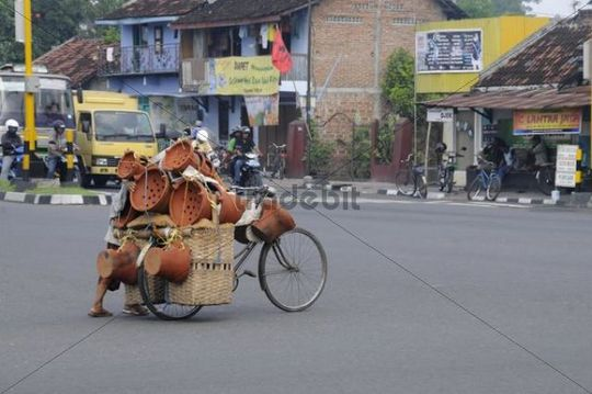 Contrast between modern and traditional transportation means, motorcycle - bicycle, Yogyakarta, Central Java, Indonesia, Southeast Asia, Asia