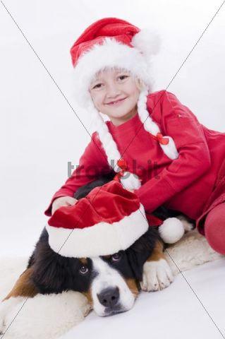 Girl and dog with Christmas hats