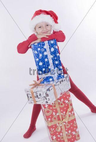 Girl with Christmas hat and Christmas presents